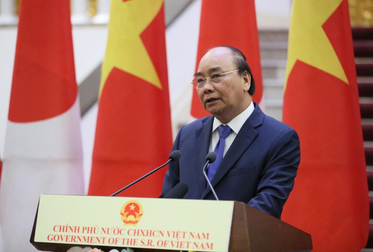 Thủ tướng Nguyễn Xuân Phúc chủ trì lễ đón Thủ tướng Nhật Bản ảnh 11