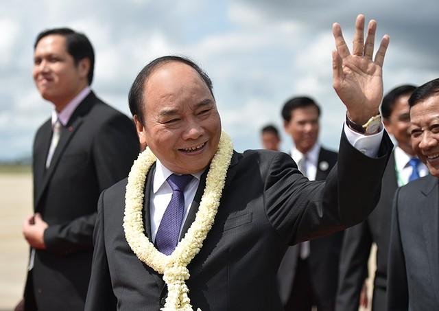 Thủ tướng tới Siem Reap dự Hội nghị cấp cao Campuchia-Lào-Việt Nam lần thứ 9 ảnh 2