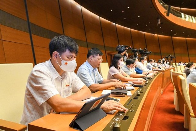 100% đại biểu Quốc hội biểu quyết thông qua cơ cấu tổ chức Chính phủ nhiệm kỳ mới ảnh 1