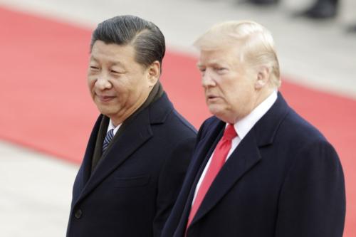 Chủ tịch Trung Quốc - Tập Cận Bình và Tổng thống Mỹ - Donald Trump. Ảnh: Bloomberg.