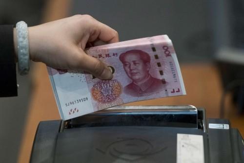 NDT có thể chạm ngưỡng tâm lý 7 NDT đổi 1 USD nếu không có tiến triển mới trên bàn đàm phán Mỹ - Trung. Ảnh: Bloomberg.
