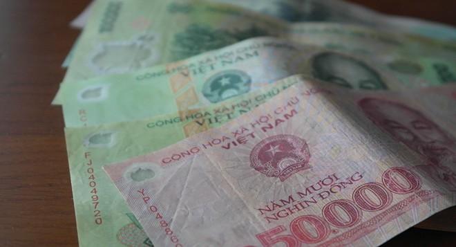 Phá hoại, hủy hoại tiền Việt Nam trái pháp luật sẽ bị phạt tiền