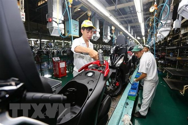 Dây chuyền lắp ráp xe ôtô tại Công ty Honda Việt Nam tại Vĩnh Phúc. (Ảnh: Danh Lam/TTXVN)