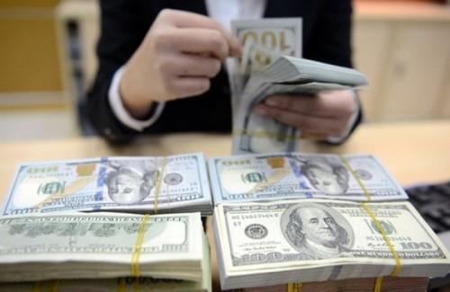 Fed giảm lãi suất, điều hành tỷ giá vẫn lo