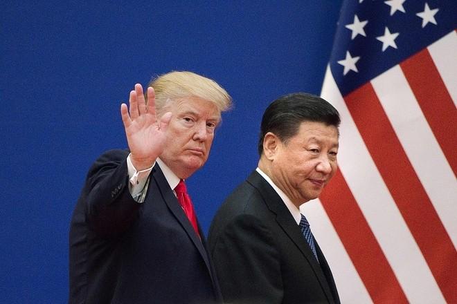 Tổng thống Mỹ Donald Trump (trái) và Chủ tịch Trung Quốc Tập Cận Bình. Ảnh: AFP
