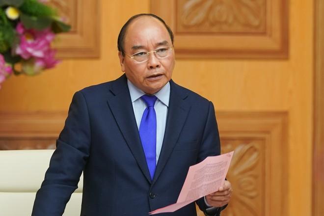 Thủ tướng Nguyễn Xuân Phúc: Chính phủ khuyến nghị mọi người dân đeo khẩu trang khi đến chỗ đông người. Ảnh: VGP