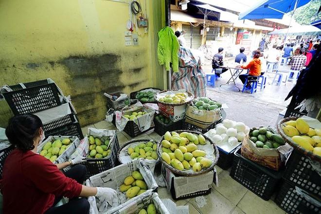 Hình ảnh Hà Nội xét nghiệm nhanh Covid-19 tại chợ Long Biên ảnh 11