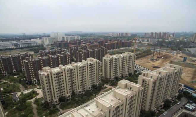 Doanh số bất động sản tính theo mét sàn tại Trung Quốc tăng 9,7% trong tháng 5. Ảnh: AFP