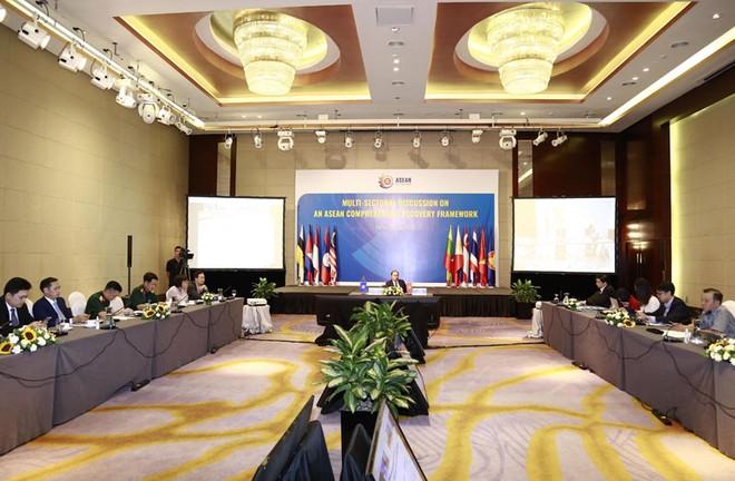 Thứ trưởng Bộ Ngoại giao Nguyễn Quốc Dũng điều hành cuộc họp từ điểm cầu Việt Nam