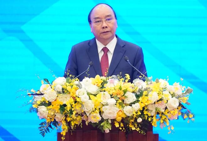 Thủ tướng Nguyễn Xuân Phúc công bố thành lập Kho dự phòng vật tư y tế khẩn cấp ASEAN. Ảnh: VGP/Quang Hiếu