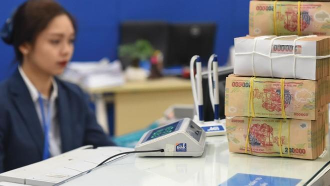 Áp lực xử lý nợ xấu sẽ tăng cao trong năm 2021 khi Thông tư 01 chưa được sửa đổi. Ảnh: Dũng Minh