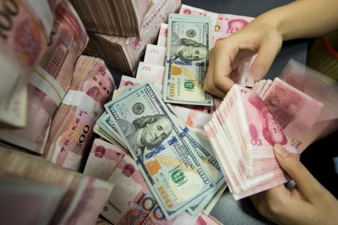 Nợ quốc gia của Trung Quốc đã tăng lên gần 4 lần GDP. Ảnh: AFP