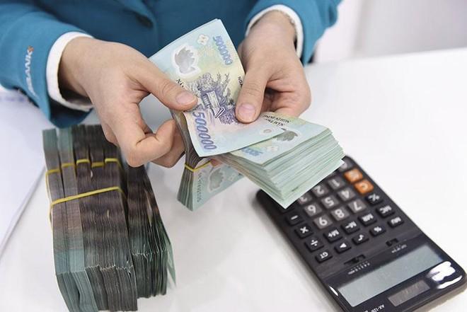 Lãi lớn trong 6 tháng đầu năm, song chất lượng tài sản của nhiều ngân hàng đang suy giảm. Ảnh: Dũng Minh