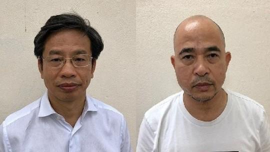 Bị can Nguyễn Xuân Sơn (trái) và Vũ Trọng Hải (phải)