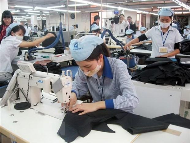 Sản xuất hàng dệt may xuất khẩu. (Ảnh: Đỗ Phương Anh/TTXVN).
