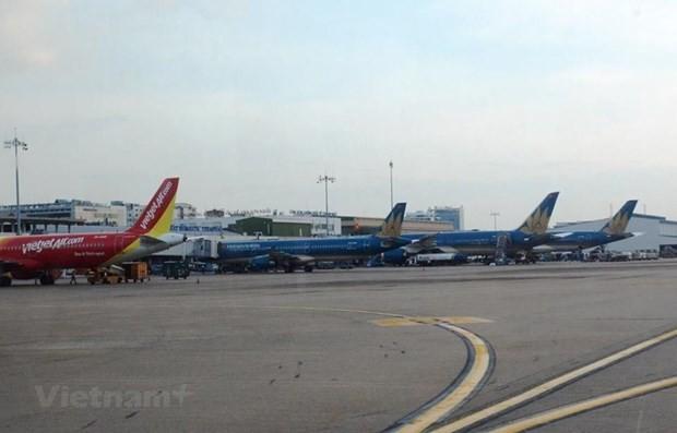 Máy bay của các hãng hàng không Vietnam Airlines và Vietjet. (Ảnh: Việt Hùng/Vietnam+).