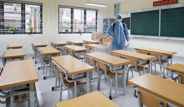 Phun khử khuẩn trường học đón học sinh trở lại. (Ảnh minh họa: Thanh Tùng/TTXVN).
