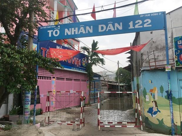 Một hẻm thuộc ấp Tam Đông 3 (xã Thới Tam Thôn, huyện Hóc Môn) bị phong tỏa do liên quan đến các ca nghi nhiễm COVID-19. (Ảnh: Tiến Lực/TTXVN).