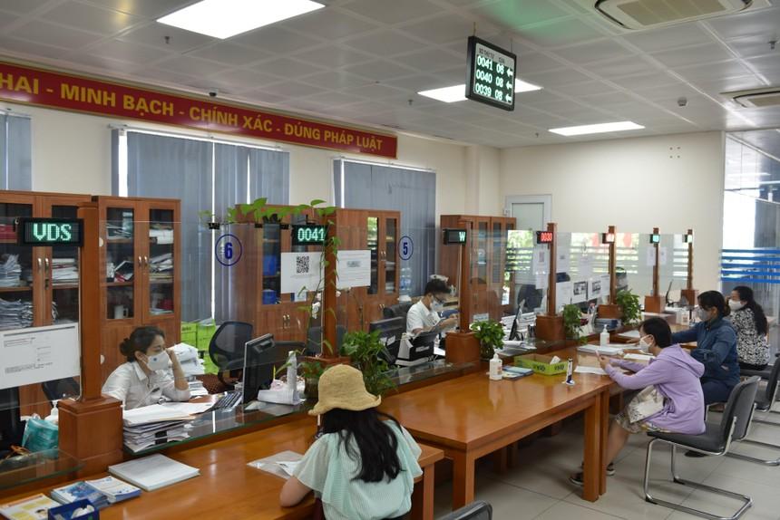 BHXH Việt Nam luôn nỗ lực đưa các chính sách hỗ về BHXH, BHTN đến doanh nghiệp và NLĐ một cách nhanh nhất. (Nguồn ảnh: BHXH Tp.Hà Nội).
