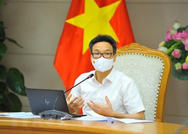 Phó Thủ tướng Vũ Đức Đam chủ trì cuộc họp. (Ảnh: Minh Đức/TTXVN).