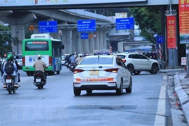 Xe taxi được phép hoạt động 50% số lượng phương tiện được Sở cấp phù hiệu còn hiệu lực. (Ảnh: Tuấn Anh/TTXVN).