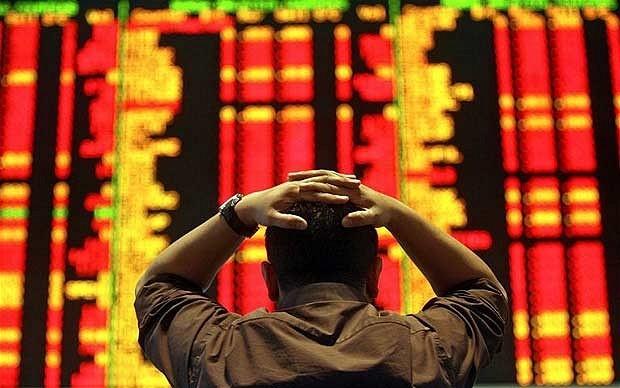 Thị trường chứng khoán Trung Quốc giảm gần 8% khi đóng cửa phiên đầu tuần. Ảnh: AFP