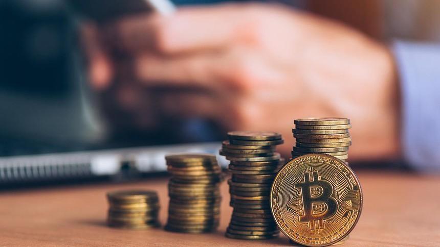 Bitcoin tiếp tục đạt kỷ lục mới, gần 60.000 USD