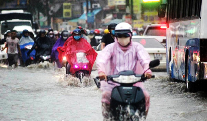 Do chưa thể thực hiện các dự án nên tình trạng ngập nước khi trời mưa vẫn diễn ra ở một số điểm tại TP. Biên Hoà. Ảnh: Phạm Tùng