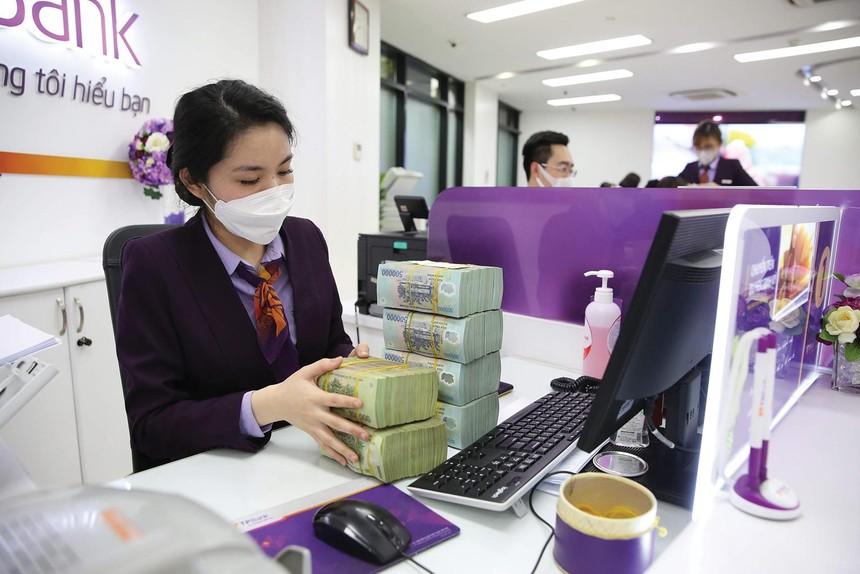 Nợ xấu sẽ tích cực hơn nếu sớm xây dựng và vận hành sàn giao dịch nợ xấu theo thông lệ quốc tế. Ảnh: Dũng Minh