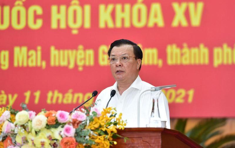 Bí thư Thành ủy Hà Nội Đinh Tiến Dũng trình bày chương trình hành động (Ảnh - Báo Hà Nội Mới).