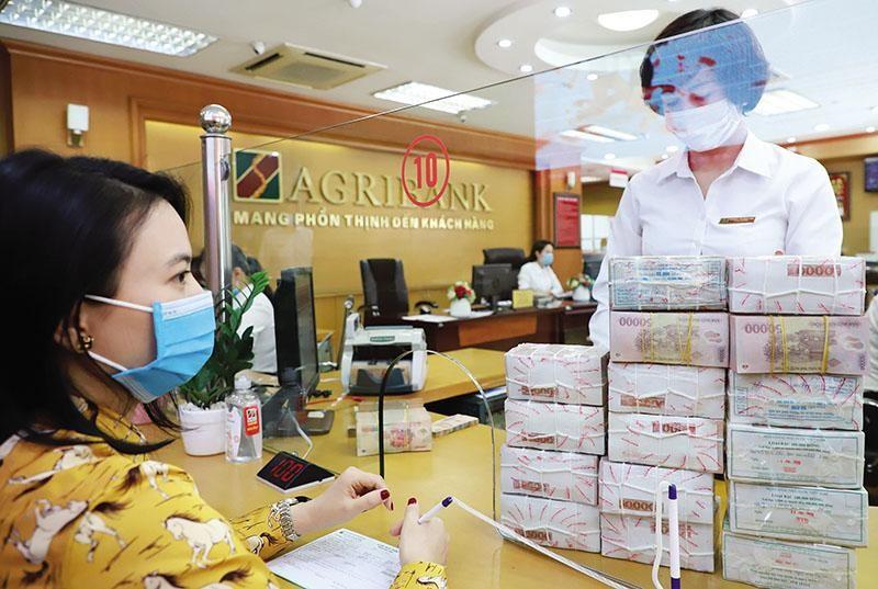 Agribank vẫn là quán quân về tổng thu nhập hoạt động trong 6 tháng đầu năm, đứng trên BIDV, Vietcombank và VietinBank. Ảnh: Đức Thanh